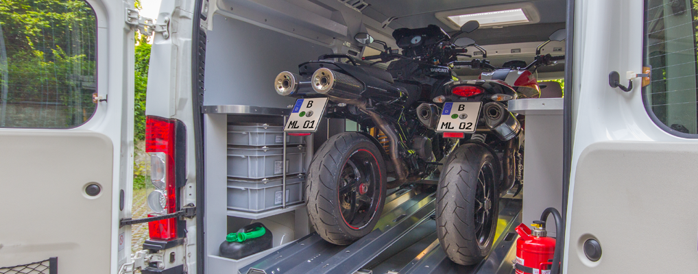 Two MOTOLOADER systems with two motorcycles in a van