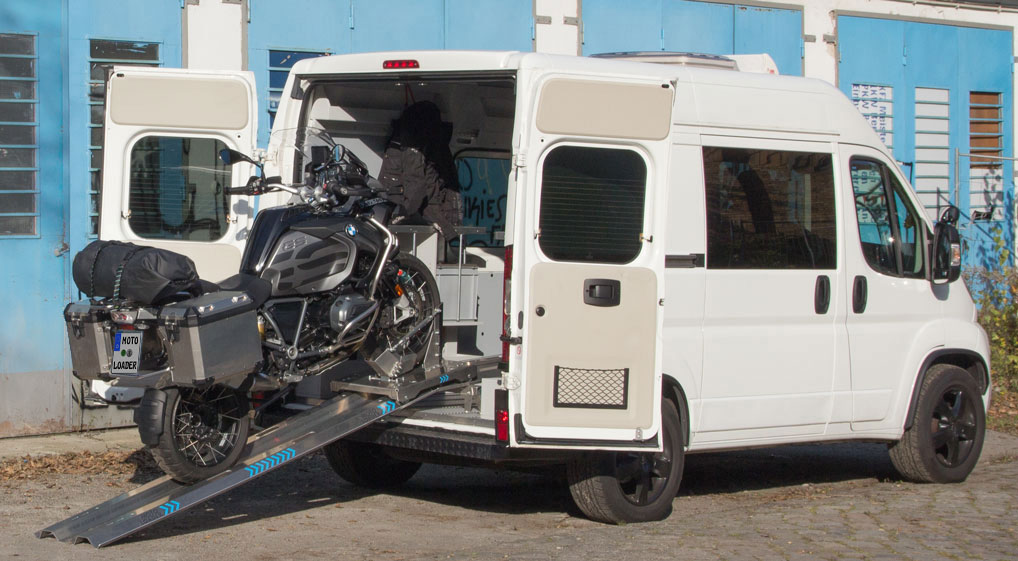 Fully equipped BMW GS loaded into a van with the MOTOLOADER loading system